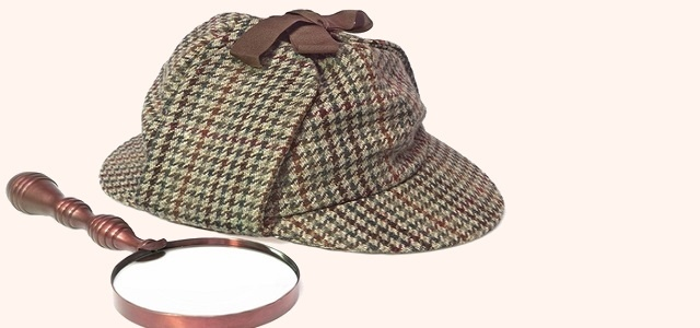 Sherlock Holmes Hat or Deerstalker Hat and Retro Magnifying Glass Isolated on White